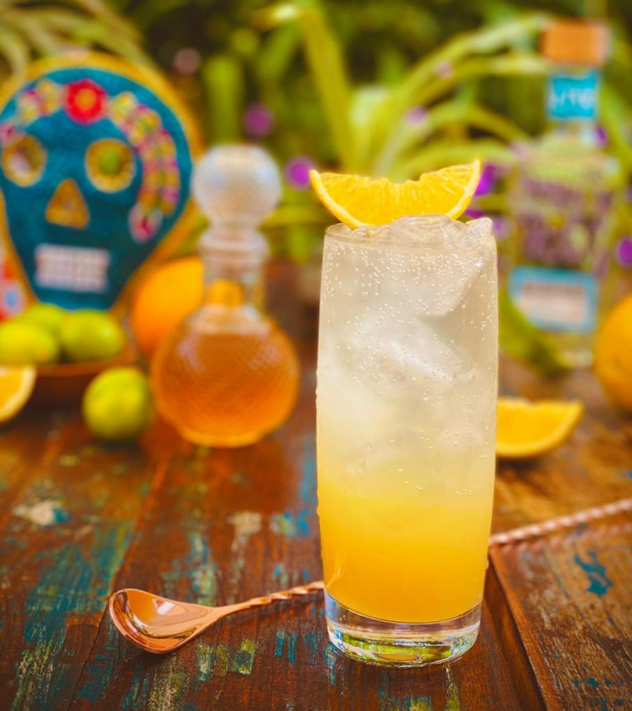 This Altos Agave Paloma is slightly smoky because of the Vida Mezcal, ía de muertos, dia de los muertos cocktail recipes, mexican tradition, drinking traditions,