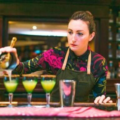 Kelsey Ramage. A bartender serving cocktails.