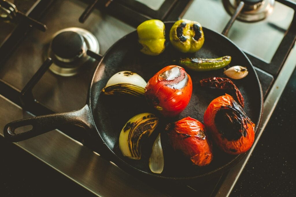 Tomatoes, chiles and onions on a comal, tomato puree, ortega brand, tomato sauce, hot sauce, sauce taste, garlic powder,