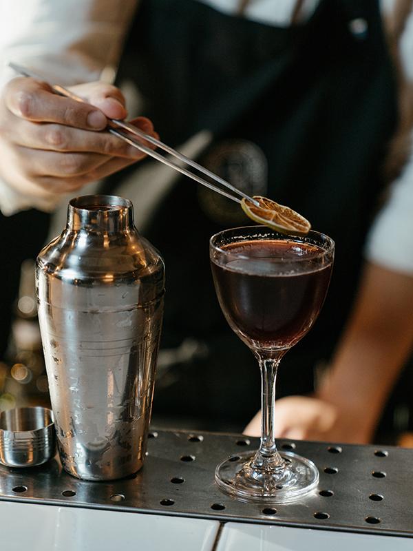 Bartender decorating a cocktail, business model, training program, social responsibilities,