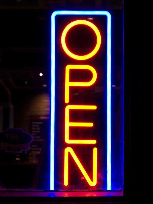 Neon sign in a bar, successful social entrepreneur, social enterprises, social problems,