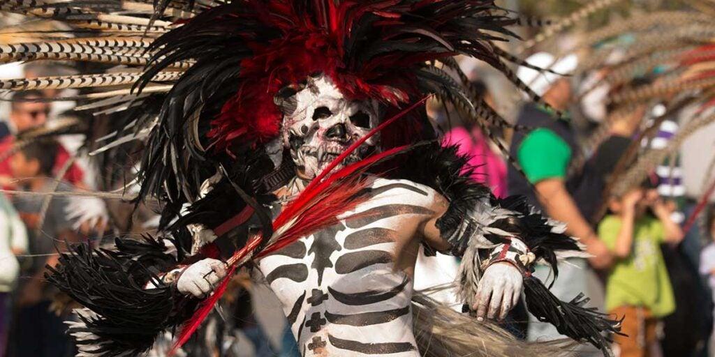 Skeleton dancing on a parade in Mexico City, mexican ofrenda, dia de los muertos, día de los muertos celebration, día de muertos,