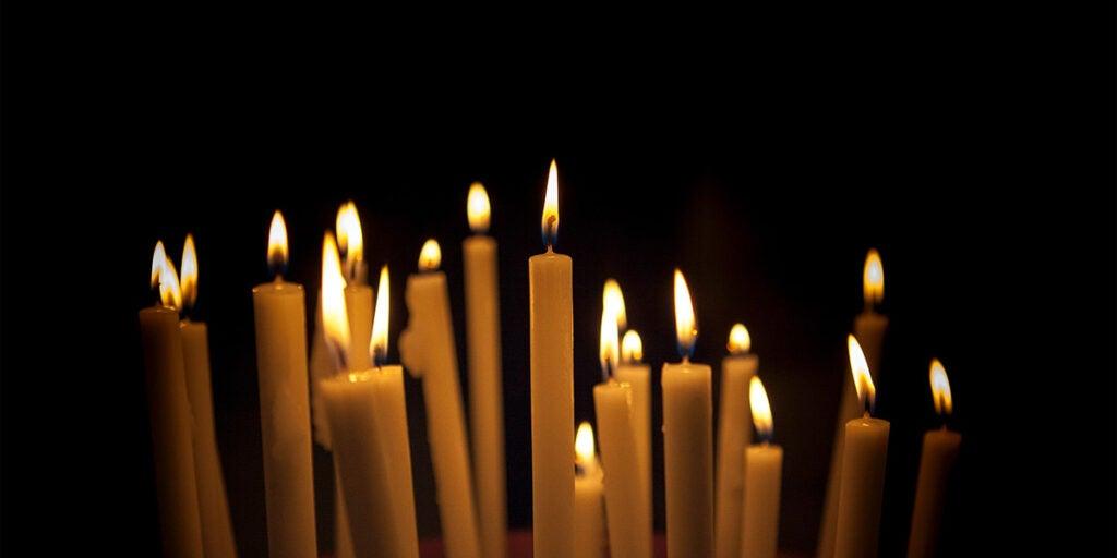 Candles in the altar, papel picado, pan de muerto, sugar skulls, deceased person,
