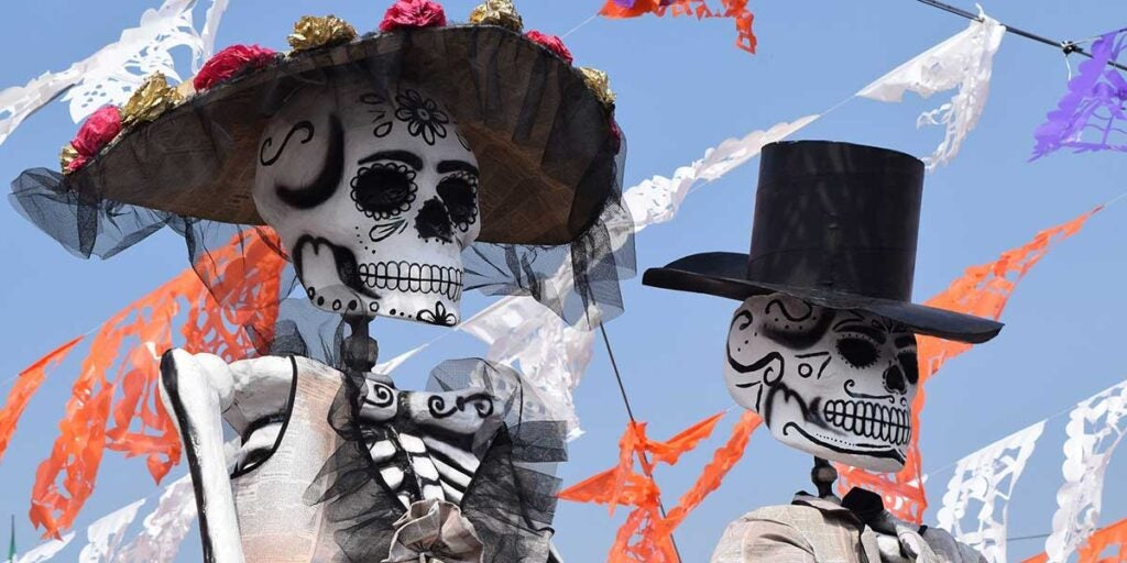 Catrina and Catrin on a parade in Mexico City, day of the dead ofrenda, Mexican day of the dead ofrenda, traditional day of the dead ofrenda,